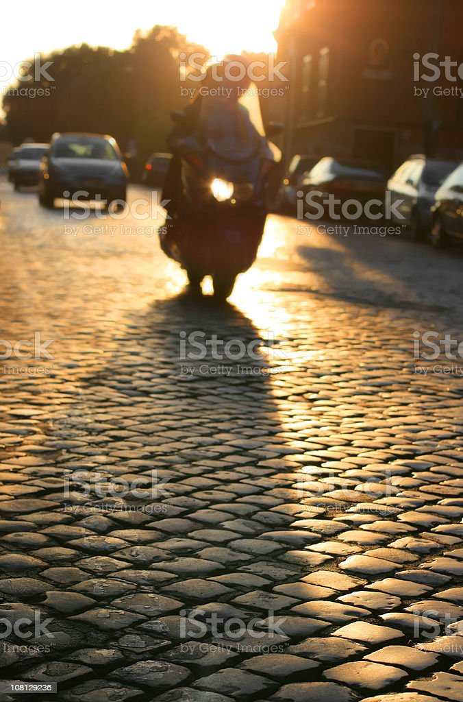 Roman scooter silhouette at dusk, Rome Italy royalty-free stock photo