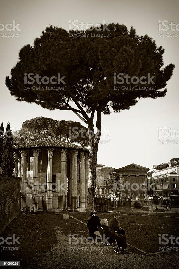 roman seniors in a park stock photo