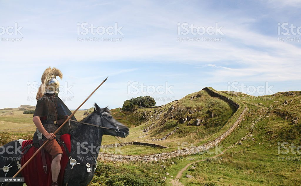 Roman Soldier guarding Hadrians Wall stock photo