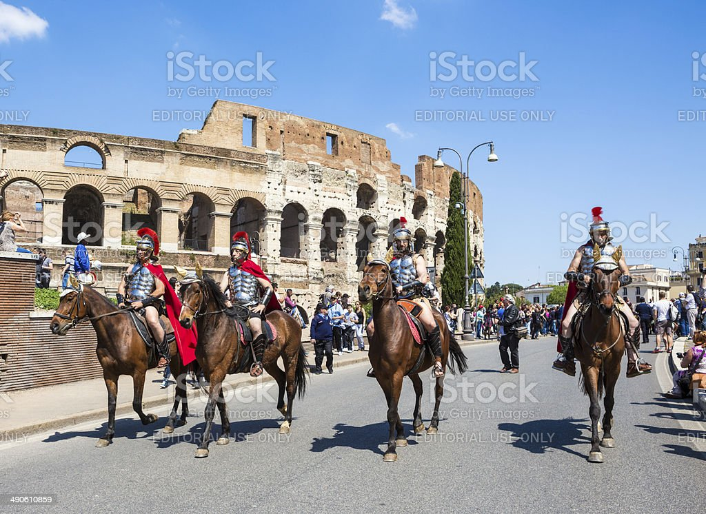 Roman soldiers horseback riding in a historical parade, Rome Italy stock photo