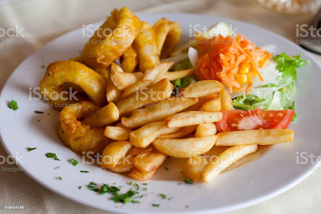 Roman style squid with fries stock photo