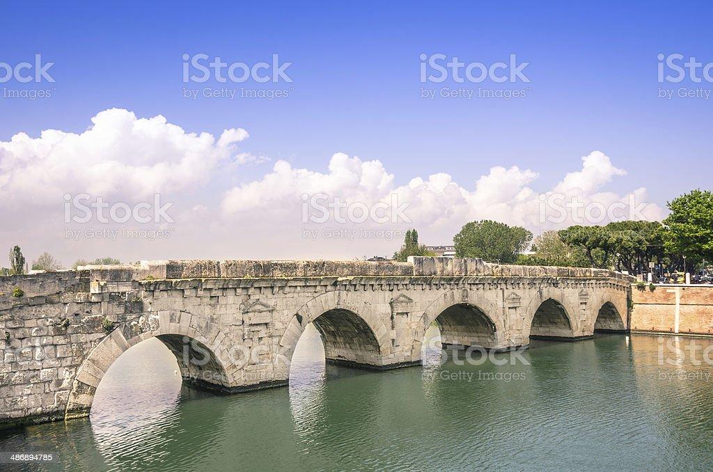 Roman Tiberius Bridge on Marecchia river in Rimini Italy stock photo