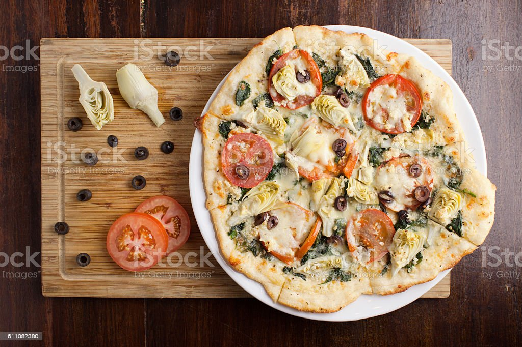Roman Vegetarian Pizza on wooden cutting board stock photo