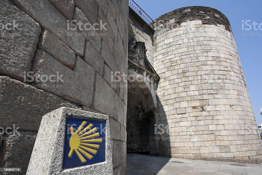 Roman wall and 'camino de santiago' stock photo