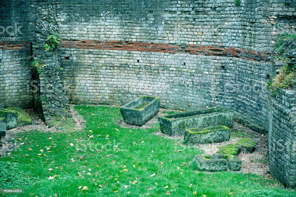 Roman wall and sarcophagi in York England stock photo