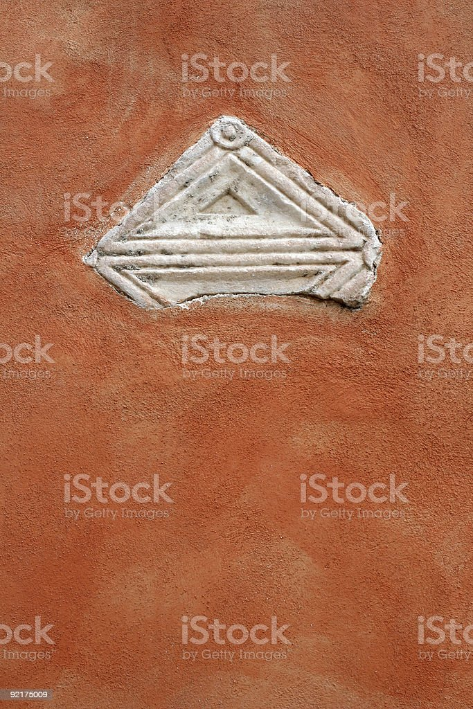 Roman wall with a piece of ancient marble, Rome Italy royalty-free stock photo