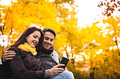 Romance couple enjoying in park in autumn.