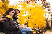 Romance couple enjoying in park in autumn.