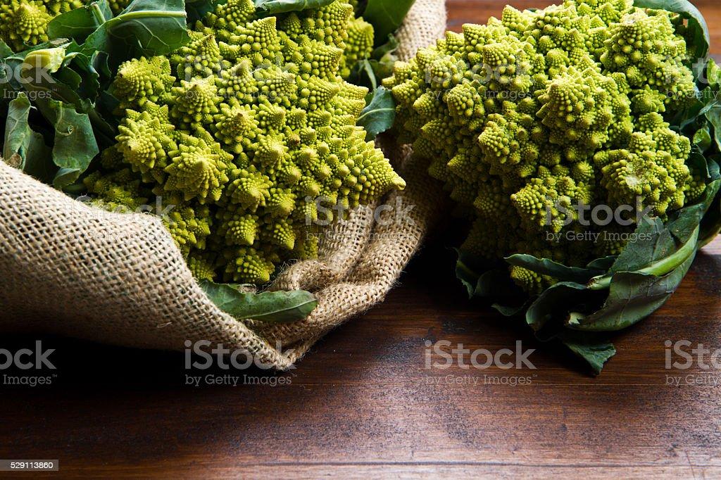 Romanesco broccoli cabbage on wood stock photo
