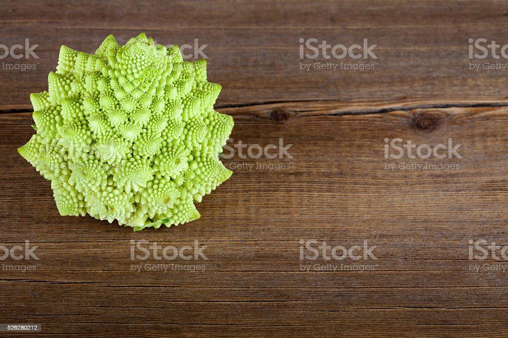Romanesco broccoli cabbage (or Roman Cauliflower) on wooden stock photo