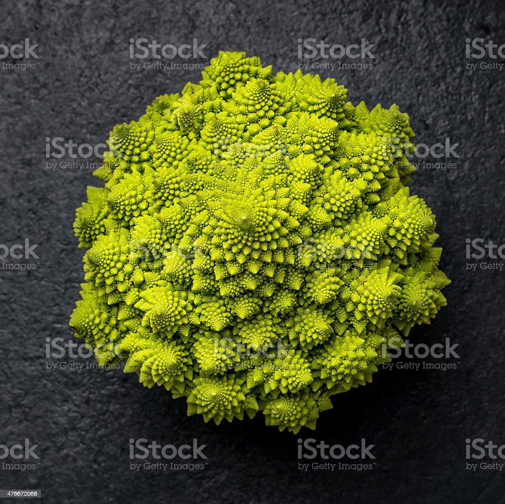 romanesco cabbage on dark background, top view stock photo