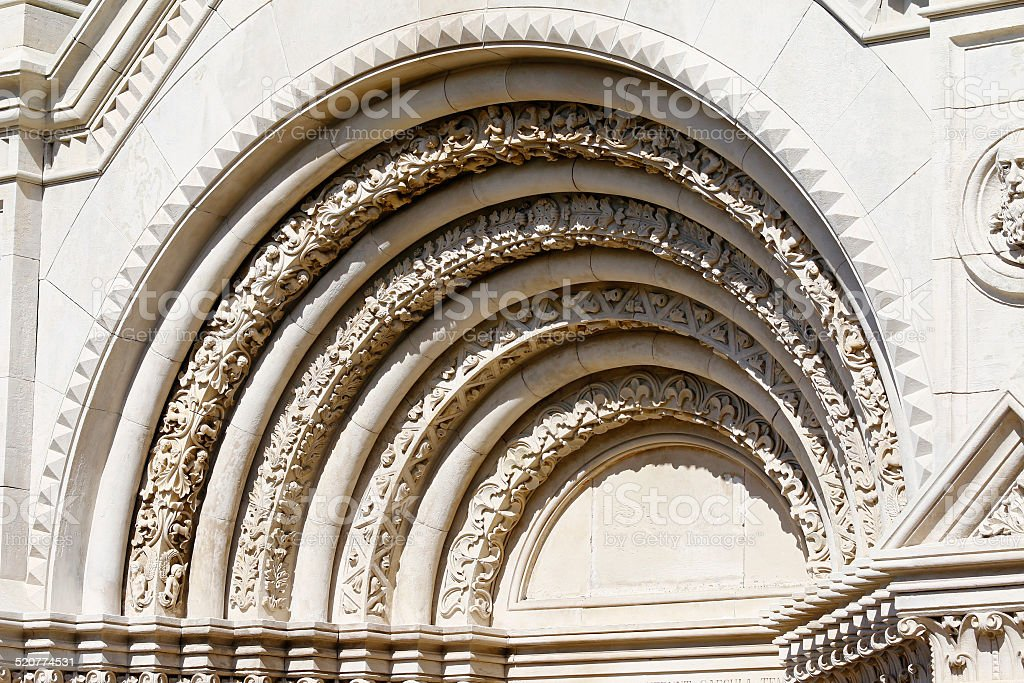 Romanesque arch over the entrance to the monastery stock photo