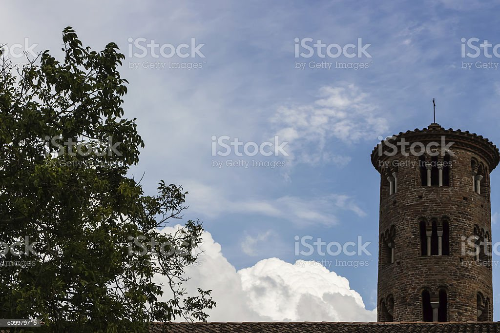 Romanesque cylindrical bell tower of countryside church stock photo