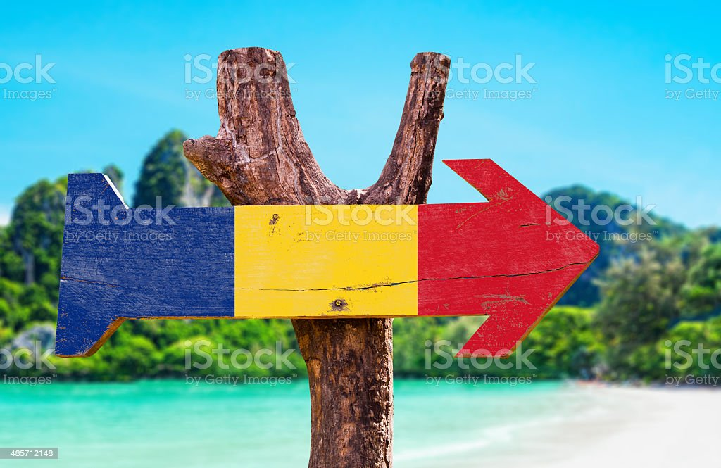 Romania Flag wooden sign with beach background stock photo