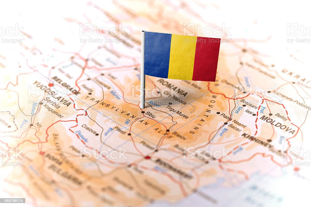 Romania pinned on the map with flag stock photo