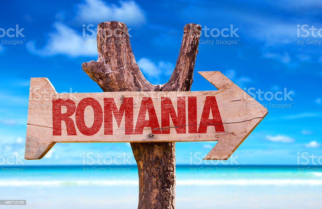 Romania wooden sign with beach background stock photo