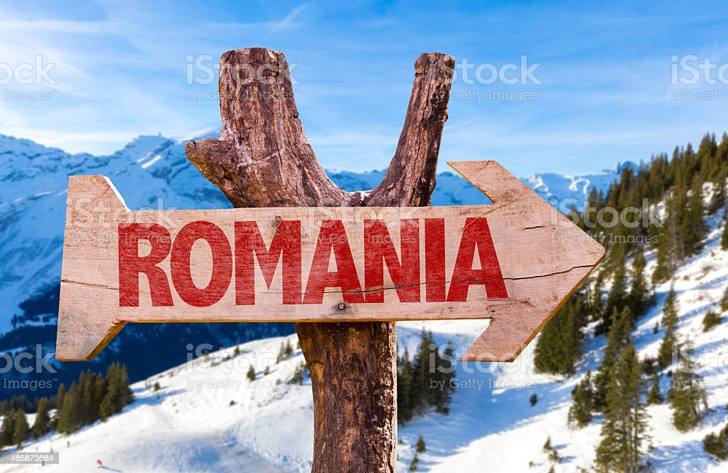 Romania wooden sign with winter background stock photo