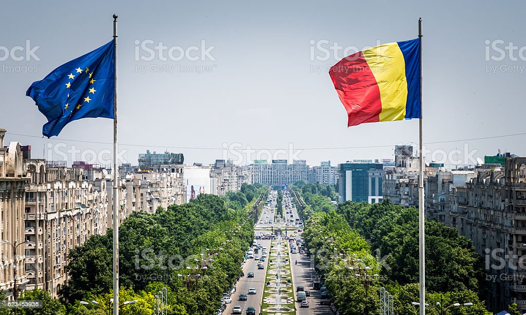 Romanian and European Union flag flying in Bucharest, Romania stock photo