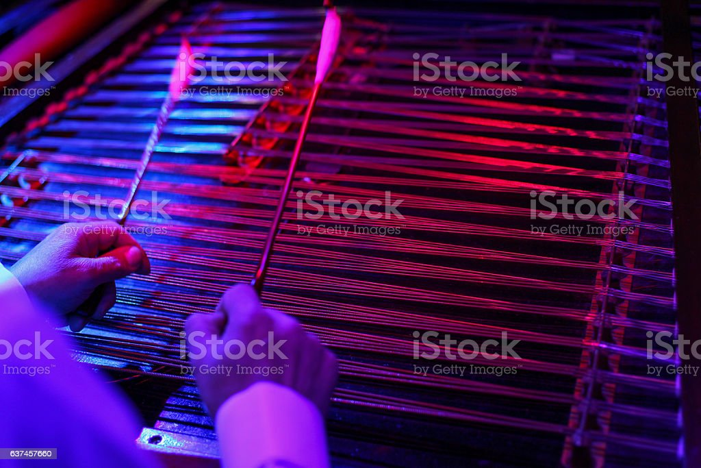 Romanian Dulcimer with hands and hammers stock photo