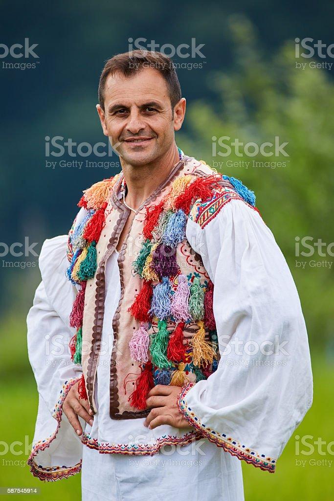 Romanian farmer in traditional costume stock photo