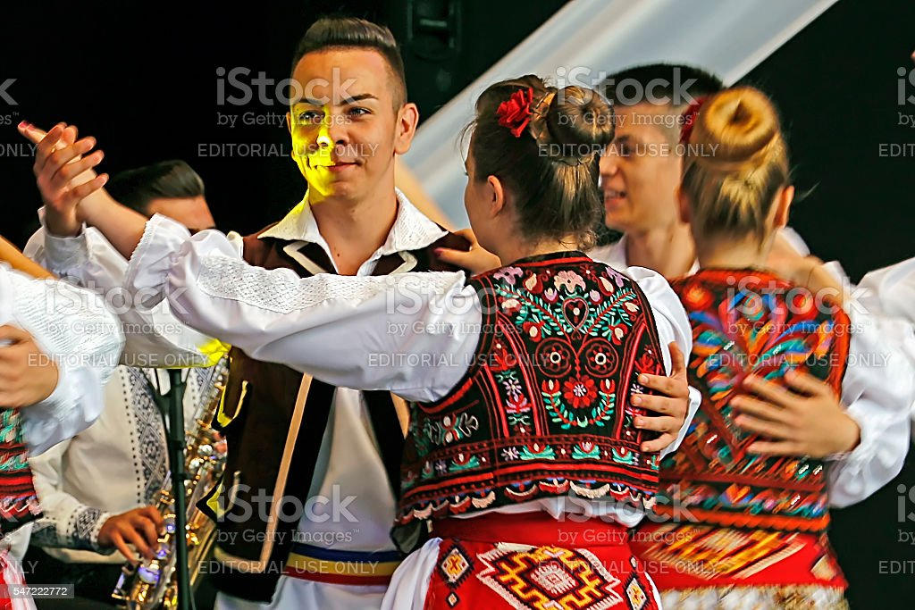 Romanian folk dancers perform in a show stock photo