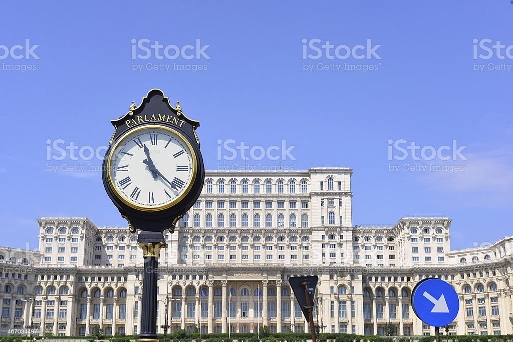 Romanian Parliament building and clock stock photo