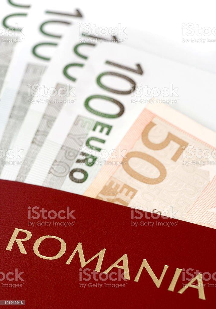 Romanian passport with European money stock photo