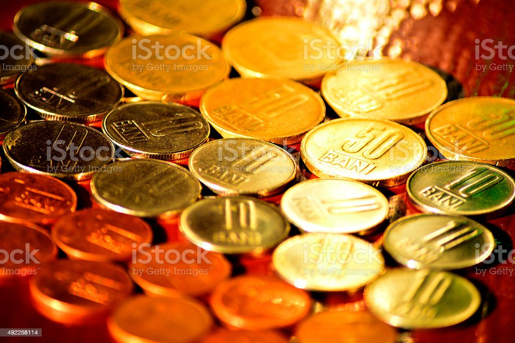 Romanian's coins in sunlight stock photo