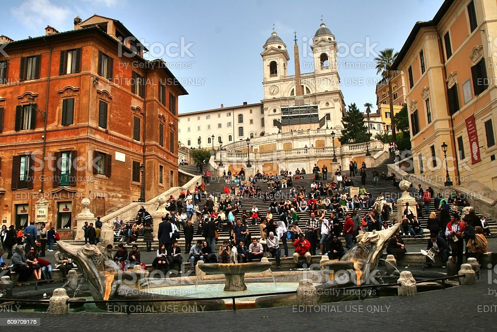 romans and tourists sit on the spanish steps in rome stock photo
