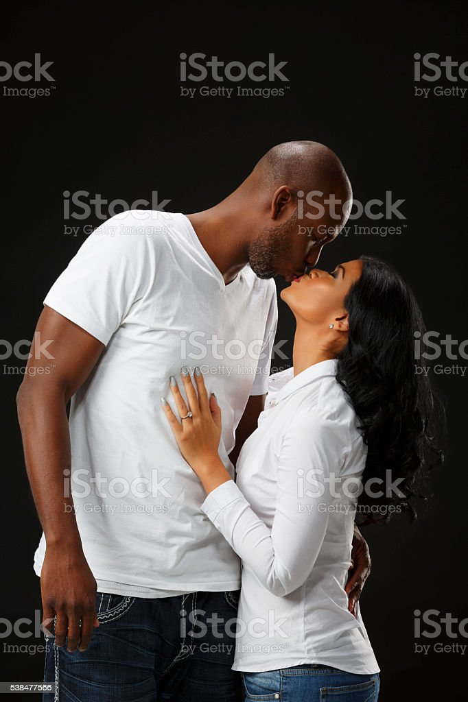 Romantic African American Couple Hugging and Kissing stock photo