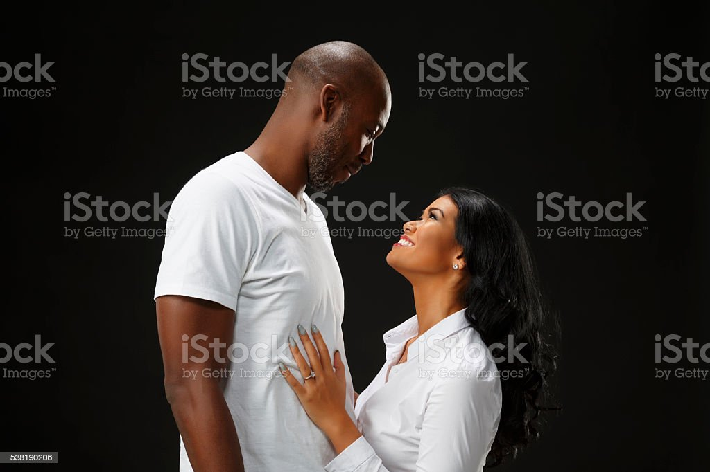 Romantic  African American Couple Hugging and Smiling stock photo