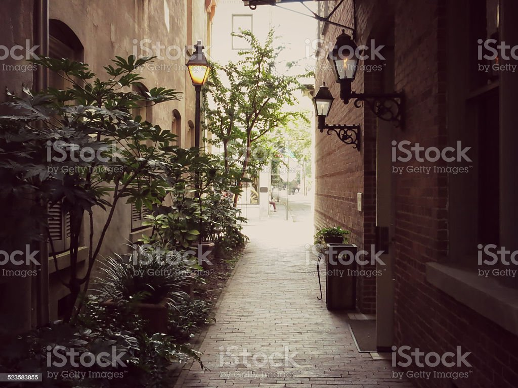 Romantic Alley with Gas Lamps in Charming Charleston, Scouth Carolina stock photo