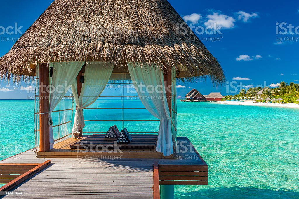 Romantic and luxurious overwater spa with tropical lagoon view stock photo