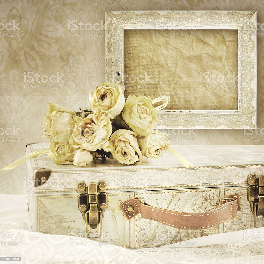 Romantic background with suitcase and bouquet of rose. stock photo