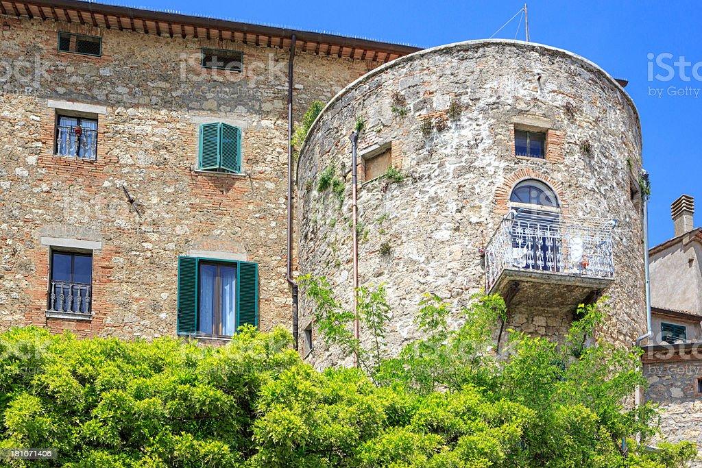 Romantic balcony on old house in Sarteano, Tuscany, Italy. stock photo