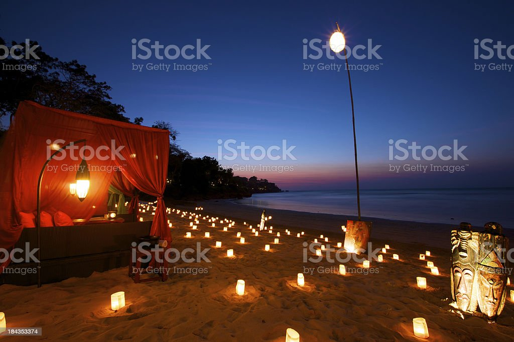 Romantic beach front dinner at tropical paradise stock photo