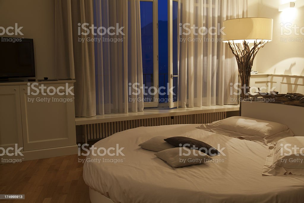 romantic bedroom at evening royalty-free stock photo