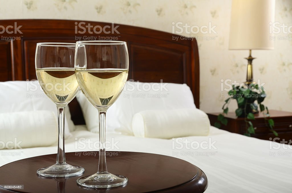 Romantic Bedside White Wine For Two stock photo