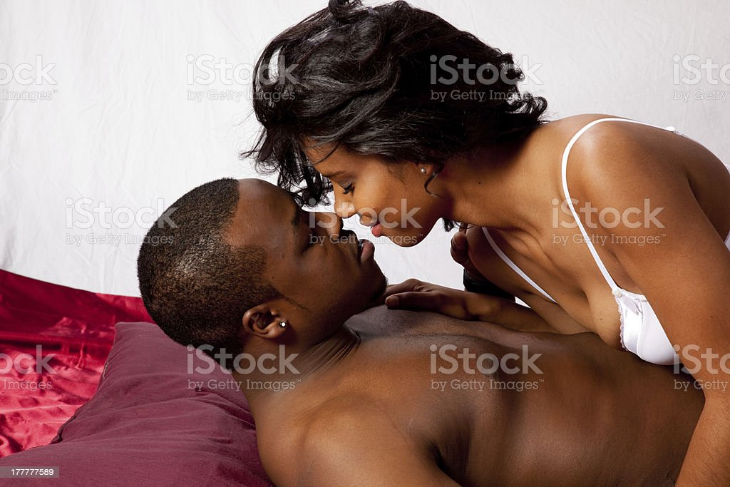 Romantic black couple in their underwear stock photo