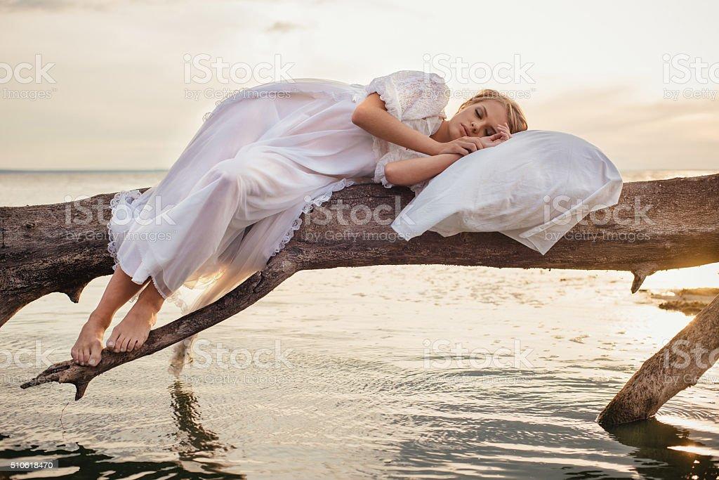 Romantic blonde woman sleeping on the fresh air stock photo