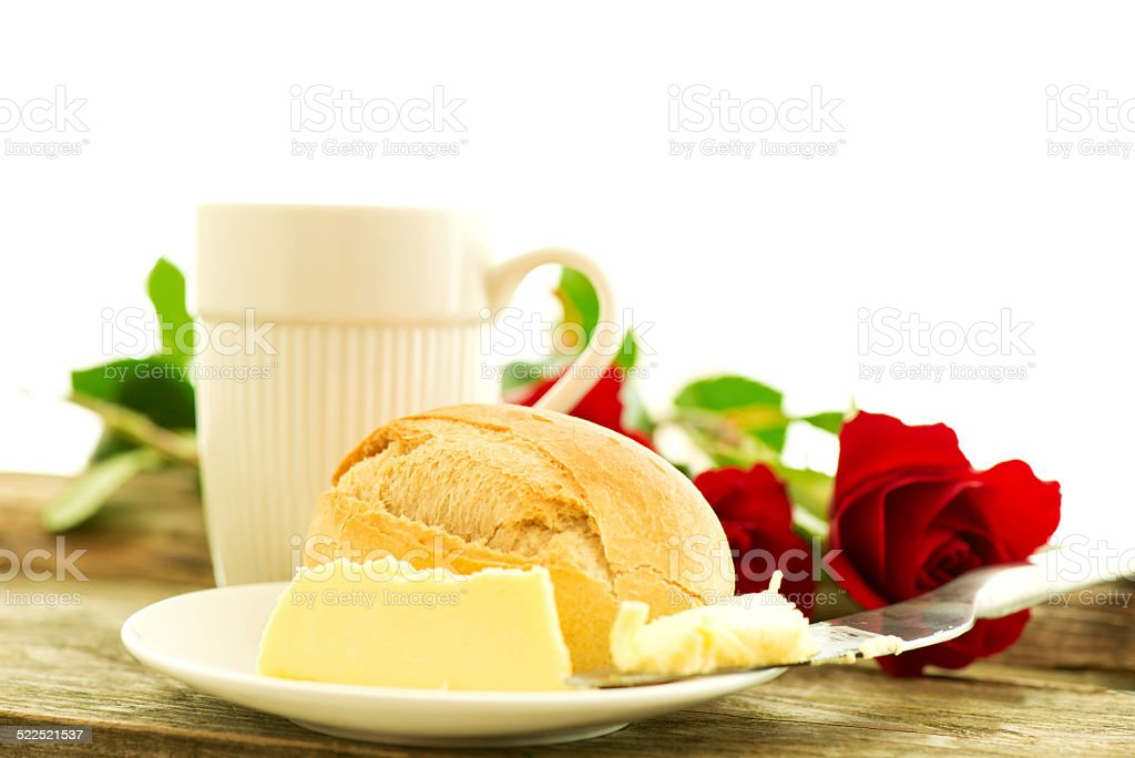 Romantic breakfast with red flowers stock photo