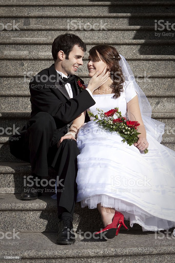 Romantic Bride and Groom Sitting on Stairs royalty-free stock photo