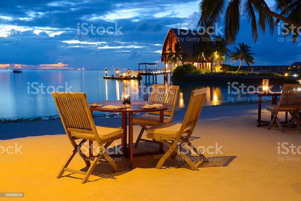 Romantic Candlelight Beach Dinner at Seaside Restaurant stock photo