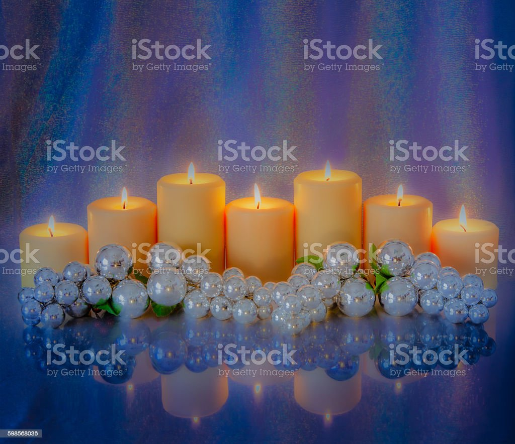 Romantic Candlelight centerpiece in icy deep purple and silver (P) stock photo