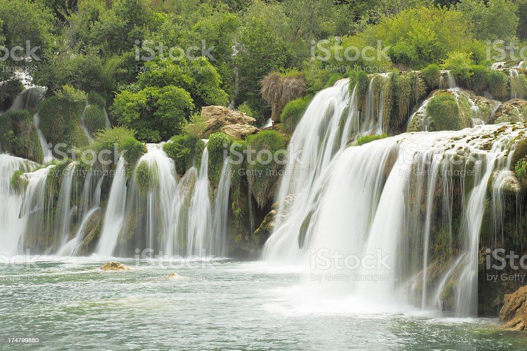 romantic cascade with streaming water rocks and green Croatia Krka royalty-free stock photo