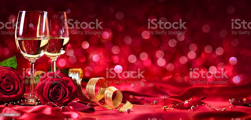 Romantic Celebration Of Valentine's Day - With Wine And Roses stock photo