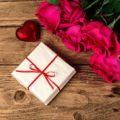 Romantic composition with rose flowers and gift St. Valentines Day