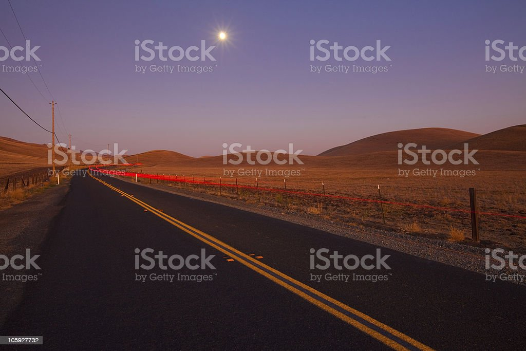 Romantic country road at dusk royalty-free stock photo