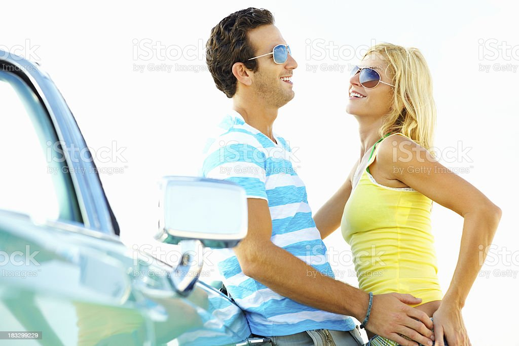 Romantic couple against convertible car spending time together royalty-free stock photo