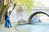 Romantic Couple At A Riverbank